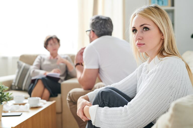 Sad thoughtful wife at therapy session